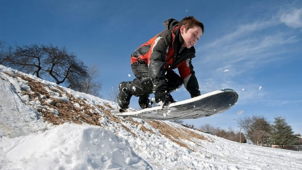 Adam Harmes, 9 launches off a jump while sledding on Feb. 14, 2014, in Harrisonburg, Va. A winter blast left parts of the U.S. Northeast buried under a foot of snow on Sunday before heading toward coastal Canada.