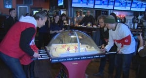 Trevor Linden plays bubble hockey