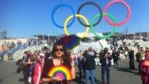 Vladimir Luxuria, an Italian gay-rights activist, says she was detained by police in Sochi. Luxuria was carrying a rainbow flag saying 'Gay is OK' in Russian.