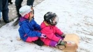 Kids tobogganing