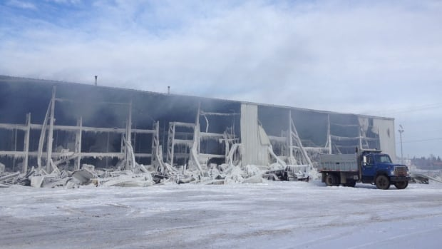 A warehouse in Saskatoon's Sutherland area continues to smoulder three days after a fire ripped through the building.