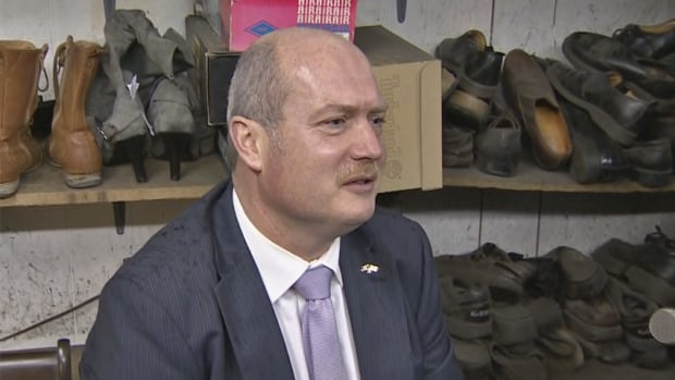 B.C. Finance Minister Mike de Jong getting his shoes resoled and refurbished on Monday. He said wearing repaired shoes was an indication of where the province is.
