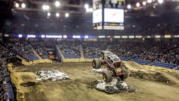 A monster truck launches through the air at Credit Union Centre in Saskatoon.