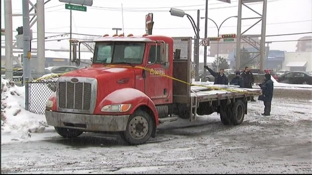 The 19-year-old driver of this flatbed truck was treated for shock after a 61-year-old woman was stuck and killed as she was crossing Taschereau Blvd.