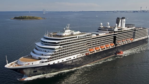 A cruise ship worker aboard a Holland America Line vessel, not the one pictured, is charged with attempt to commit murder and aggravated sexual abuse after allegedly raping a passenger and attempting to throw her overboard.