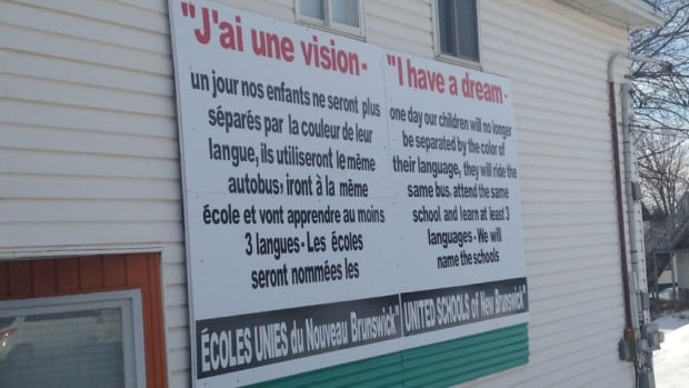 A sign denouncing language duality in the province's schools has been erected at a major intersection in Dieppe by a group called United Schools of New Brunswick.