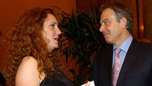 Former British prime minister Tony Blair talks with former News International chief executive Rebekah Brooks in October 2004. Jurors at Britain's phone-hacking trial were told Wednesday that Blair offered to work as an unofficial adviser to Rupert Murdoch as revelations of illegal phone hacking engulfed the mogul's empire.