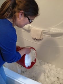 Karen Marshall dumps snow in her tub.