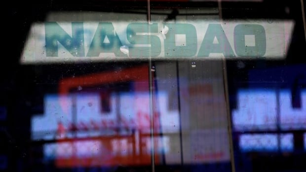 Electronic billboards are reflected in the windows of the Nasdaq exchange in New York. The exchange released plans for a 'kill switch' that would help catch trading errors.