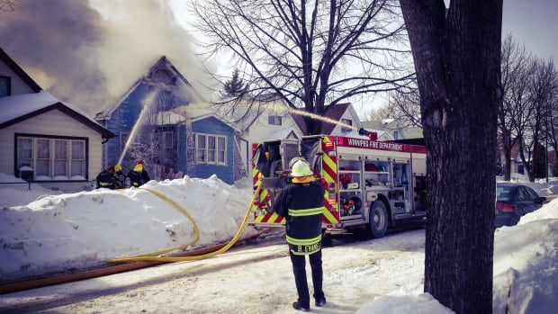 Winnipeg fire crews battle a house fire in the 800 block of Pritchard Avenue on Wednesday afternoon.