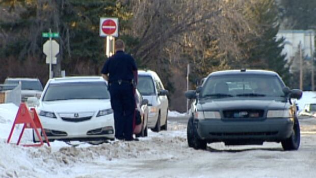 A 26-year-old woman has been charged with unsafe backing after a elderly man was hit in Calgary's northwest in January.