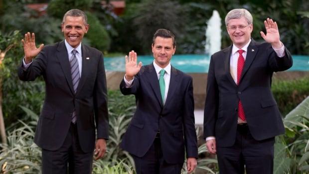 Prime Minister Stephen Harper, right, and U.S. President Barack Obama, left, seem open to renegotiating NAFTA with Mexico's President Enrique Pena Nieto.