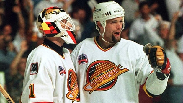 Kirk McLean (1) and Bret Hedican of the Canucks exult in a 4-1 victory in Game 6 of the Stanley Cup final on June 11, 1994.