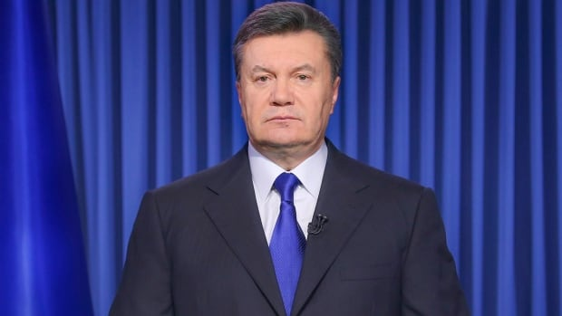 Ukrainian President Viktor Yanukovych addresses the nation on a live TV broadcast in Kyiv, Ukraine, early Wednesday, Feb. 19, 2014. In a statement published online early Wednesday, Yanukovych blamed opposition leaders for the violence, saying that they had crossed a line when they called people to arms.