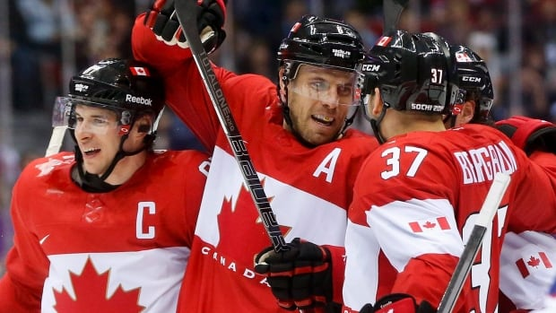 Canada's Shea Weber, centre, celebrates with Sidney Crosby, left, and Patrice Bergeron during a men's ice hockey game last Thursday. The team will play the U.S. in the semi-finals Friday.