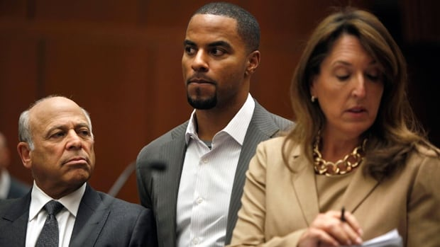 Darren Sharper, middle, stands in court flanked by lawyers Leonard Levine and Blair Berk in Los Angeles, Calif., on Thursday.
