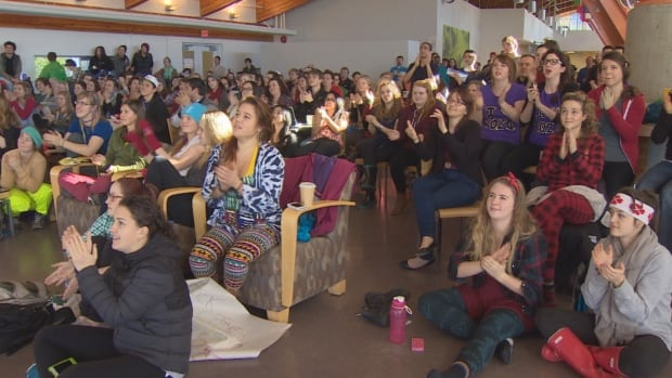Students at Quest University watch women's half pipe