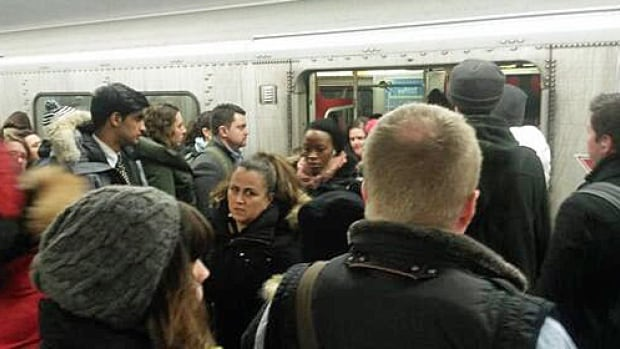 A TTC riders advocacy group has launched a photo contest to show the state of overcrowding on Toronto transit vehicles. Here a rider exiting a subway train squeezes her way through the crowd.