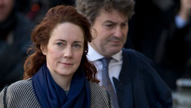 Rebekah Brooks, former News International chief executive, and her husband, Charlie Brooks, arrive at the Central Criminal Court in London where they are facing charges related to the hacking of phones belonging to celebrities and other prominent Britons.
