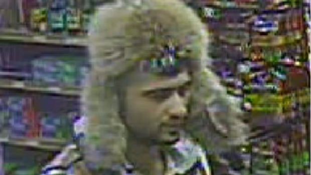 The suspect was wearing a distinctive vest and fur hat during the robbery, police say.