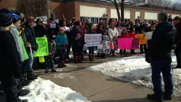Parents and students alike demonstrated outside St. Maria Goretti Catholic elementary school in Windsor on Friday.