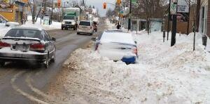 thunder bay feb. 21, 2014 buried car