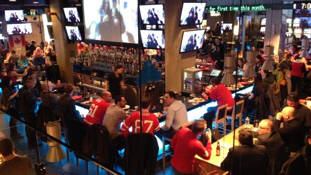Fans watch Olympic hockey at Winnipeg's Shark Club Friday morning.