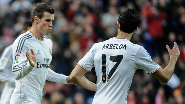 Real Madrid's Welsh forward Gareth Bale, left, and defender Alvaro Arbeloa celebrate a goal during a Spanish league match against Elche on Saturday in Barcelona. Madrid posted a 3-0 victory.