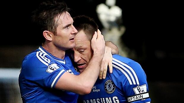 Chelsea's John Terry, right, celebrates with Frank Lampard after scoring the winning goal in a 1-0 victory over Everton in a Premier League match in London.