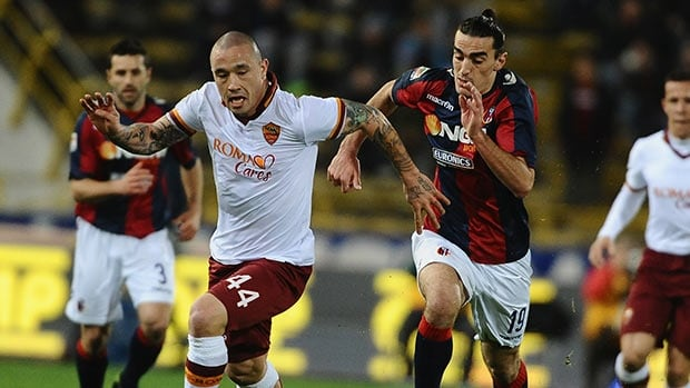 Radja Naingollan of AS Roma, left, competes against Lazaros of Bologna FC  at Stadio Renato Dall'Ara on February 22, 2014 in Bologna, Italy.