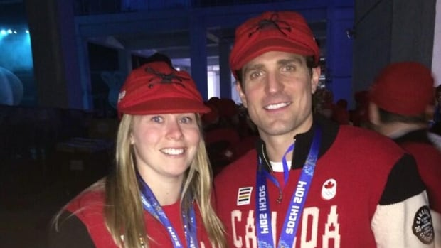 Haley Irwin and Patrick Sharp of Thunder Bay, Ont., share a golden moment during the closing ceremonies of Sochi 2014.