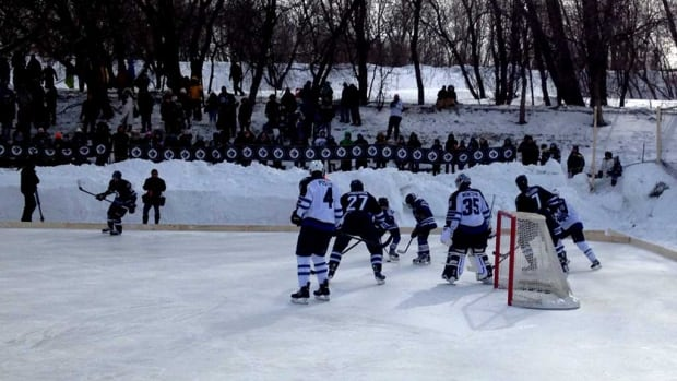 Members of the public watch as the Winnipeg Jets practise outdoors at The Forks on Feb. 23.