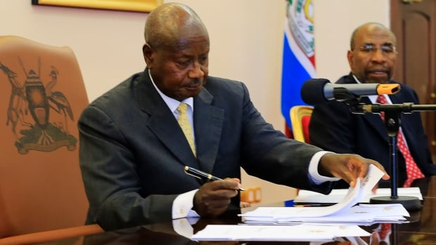 Uganda President Yoweri Museveni signed an anti-homosexual bill into law Monday, toughening already strict legislation against homosexuals.