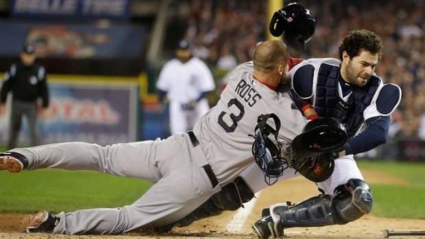 Major League Baseball is hoping to curb intentional contact by players on catchers, such as this play with David Ross, left, of the Red Sox colliding with Tigers catcher Alex Avila. Baseball's new rules on home plate collisions were released Monday.