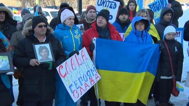 About 100 Ukrainian-Canadians rallied at the Saskatchewan Legislative Building on Sunday.