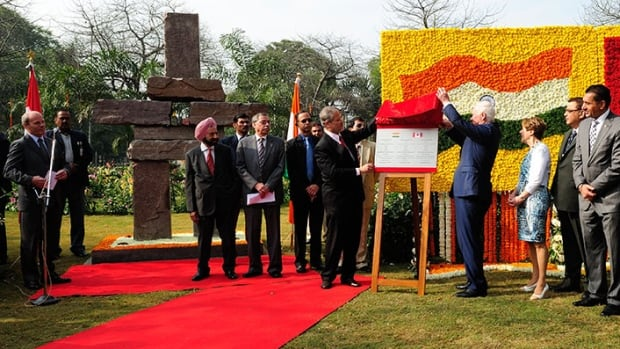 Governor General David Johnston and his wife Sharon present an Inukshuk on behalf of Canada to India.