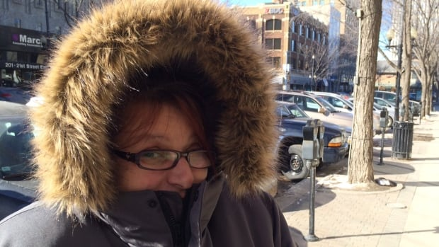 Caroline Farrell tries to stay warm while smoking a cigarette in the frigid weather in downtown Saskatoon.