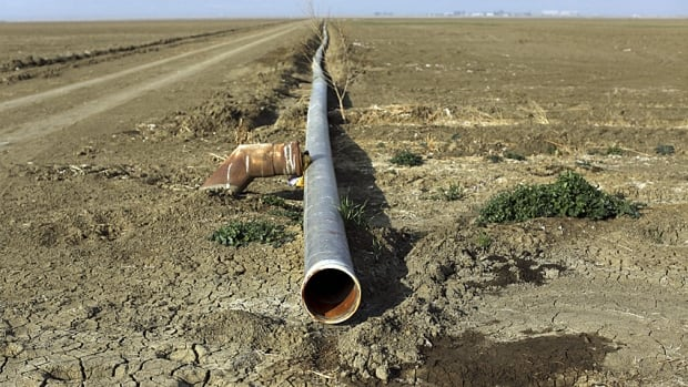 An irrigation pipe does little to relieve the crippling drought conditions that have plagued California farms, including this one near Cantua Creek.