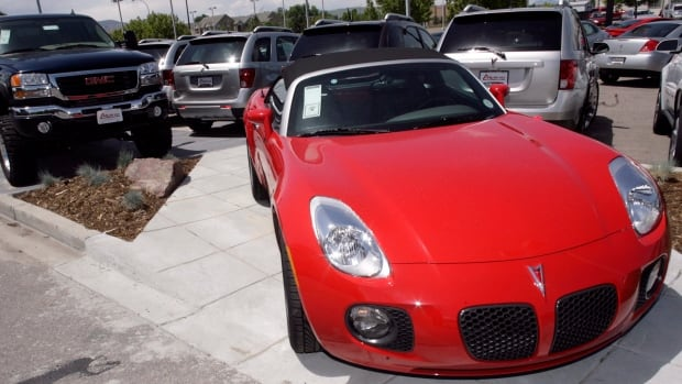 A 2007 Pontiac Solstice is show at a GM dealership. General Motors is recalling an additional 588,000 cars, including the Solstice, because of an ignition switch problem.
