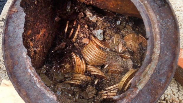 One of the six decaying metal canisters filled with 1800s-era U.S. gold coins unearthed in California by two people who want to remain anonymous. The value of the so-called Saddle Ridge Hoard treasure trove is estimated at $11 million Cdn or more.