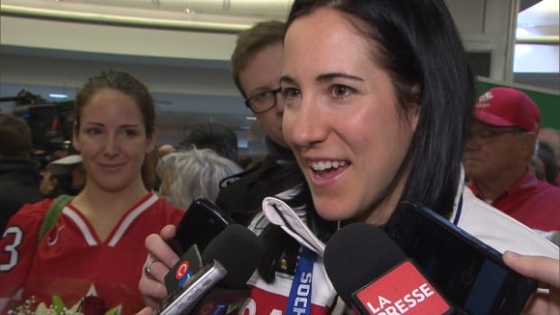 Olympic women's hockey team captain Caroline Ouellette is greeted by fans at the Montreal airport after returning from Sochi.  Ouellette and goaltender Genevieve Lacasse are joining wounded Canadian soldiers on an expedition to the magnetic North Pole that begins Tuesday.