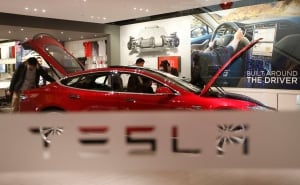 Tesla stocks surge