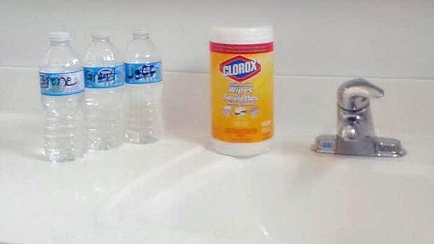 water bottles by sink