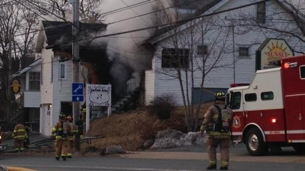 Fire crews respond to the fire at 337 Portland Street in Dartmouth Wednesday evening.
