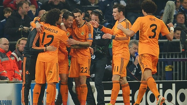 Christiano Ronaldo of Real Madrid celebrates with teammates after scoring against Schalke 04 at Veltins-Arena on February 26, 2014 in Gelsenkirchen, Germany.