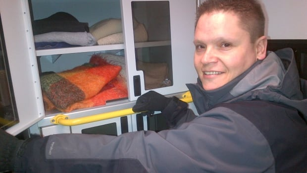 Outreach worker Tommy LaPlante, in the Lighthouse Mobile Outreach van, shows their supply of blankets, clothing and handwarmers.
