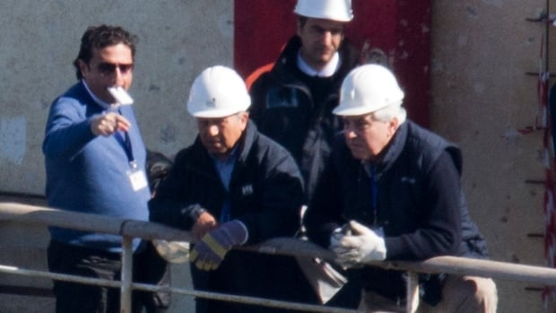 Francesco Schettino, left, talks on the upper deck of the wreck of the Costa Concordia.