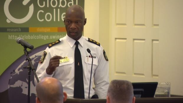 Winnipeg police Chief Devon Clunis speaks at a multi-faith leadership breakfast event at the University of Winnipeg on Thursday.