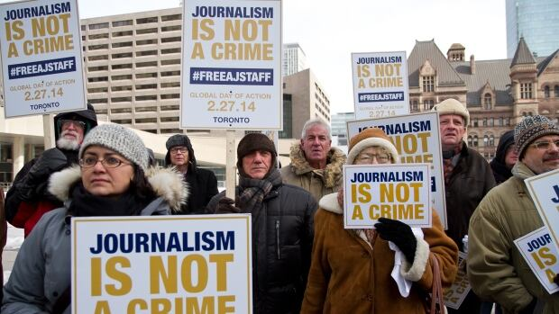 Supporters of Mohamed Fahmy and his colleagues call for their release in Nathan Phillips Square in Toronto.  Protesters also gathered in London's Trafalgar Square, Lebanon's Martyrs' Square and in Kenya's capital, Nairobi.