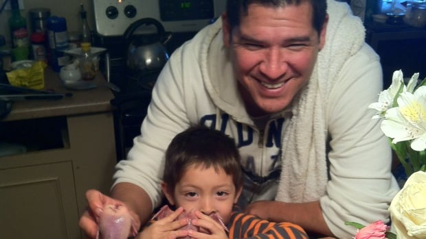 Chef Rich Francis and his son get busy in the kitchen.